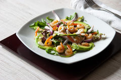 Salad with avocado and shrimps on the square ceramic plate  horizontal Royalty Free Stock Photos