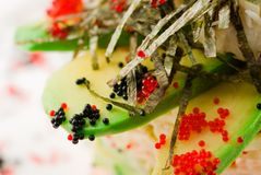 Salad from avocado and tobiko Royalty Free Stock Image