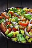 Salad with avocado, tomato, paprika  and corn Stock Photos