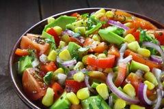 Salad with avocado, tomato, paprika and corn Stock Photography
