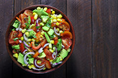 Salad with avocado, tomato, paprika  and corn Stock Image