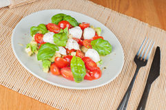 Salad with avocado, tomatoes and basil Stock Photo