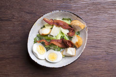 Salad with bacon cheese egg Stock Images