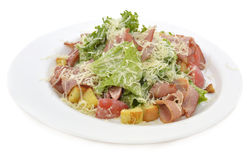 Salad with bacon on white plate Royalty Free Stock Images