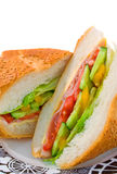 Salad Baguette. On china plate over white background Stock Photo