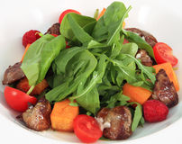Salad with baked pumpkin and chicken liver. Stock Photo