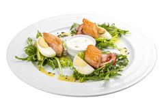 Salad with baked salmon in olive oil with tomatoes and egg stock photo