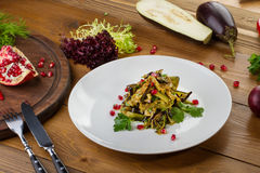 Salad of baked vegetables with pomegranate Royalty Free Stock Photos