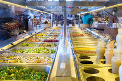 Salad bar. Bainbridge, WA, USA Feb. 11, 2017: Self-serve salad bar in upscale grocery store with a variety of freash vegetables Royalty Free Stock Photo