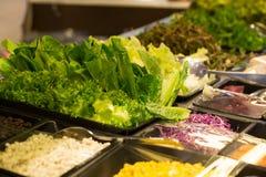 Salad bar. Green fresh vegetable on salad bar corner Royalty Free Stock Photography