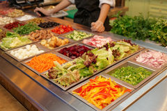 Salad bar with various fresh vegetables Stock Photos