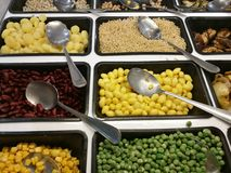Salad bar with various fresh vegetables selection and spoon,corn, green peas,lotus seeds,red yellow bean,waternut,eggplant,aubergi. Ne,onion, focus-on-foreground Royalty Free Stock Photos
