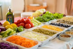 Salad bar with vegetables in the restaurant Stock Image