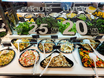 Salad bar with vegetables in the restaurant, healthy food. Salad bar 25 baht and dressing 20 baht at the supermarket salad bars Stock Photos