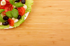 Salad with basil, mozzarella, olives and tomato Stock Photography