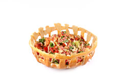 Salad basket. Season salad in a bread basket Stock Images