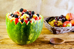 Salad and basket of fruits Royalty Free Stock Photography
