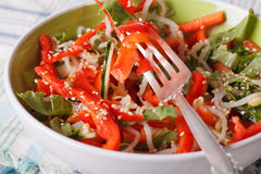 Salad with bean sprouts, peppers and sesame seeds closeup. horiz Royalty Free Stock Images
