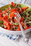 Salad with bean sprouts, peppers and sesame seeds closeup. Verti Stock Photos