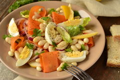 Salad with beans, egg, carrot and apple Stock Photos