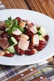 Salad with beans, smoked chicken and cucumber vertical Stock Images
