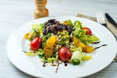Salad with beef liver and citrus fruits stock images