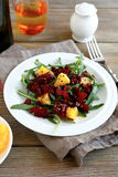 Salad with beet, arugula and orange on a white plate Royalty Free Stock Photos