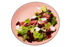 Salad with beetroot, feta cheese, lettuce, prosciutto meat, stock photography