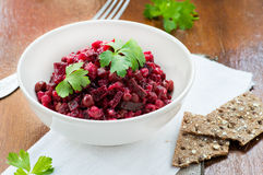 Salad with beetroot, potatoes, pickled cucumber and green peas Stock Photo