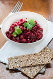 Salad with beetroot, potatoes, pickled cucumber and green peas Royalty Free Stock Photography