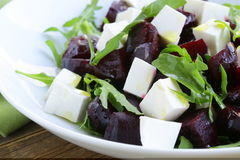 Salad with beetroot and soft feta cheese Royalty Free Stock Images