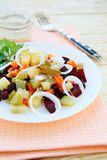Salad with beetroot on a white plate Stock Photo