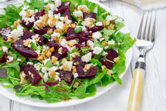 Salad with beets, feta cheese and walnuts Stock Photos