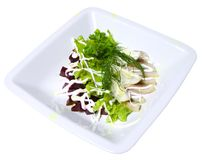 Salad of beets, lettuce, fish and eggs Stock Photo
