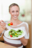 Salad being offered by woman Stock Photos