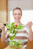 Salad being stirred by woman stock images