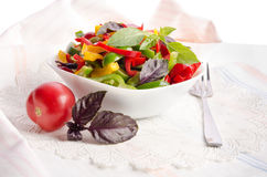 Salad from bell pepper and basil in a wooden bowl Royalty Free Stock Photo