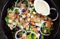 Salad in black dish Royalty Free Stock Photos