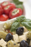 Salad of black, green olives with pieces of cheese. Royalty Free Stock Image
