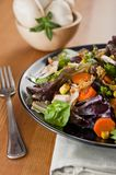 Salad. On black plate over napkin on the table stock image