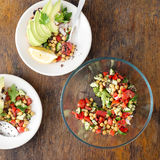 Salad of black quinoa, chickpeas and vegetables with avocado bru Royalty Free Stock Image
