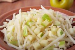 Salad with black radish, honey and apples Royalty Free Stock Image