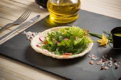 Salad on black stone background. The salad on black stone background Stock Images