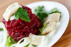 Salad with boiled beet and herring Royalty Free Stock Images