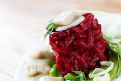 Salad with boiled beet and herring Stock Images