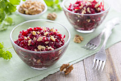Salad from boiled beetroot and walnuts Stock Photos