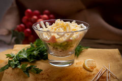Salad with boiled chiken. Cheese and vegetables in glass Stock Photography