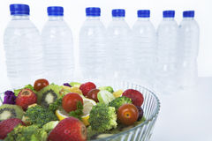 Salad and bottles of water Royalty Free Stock Photography