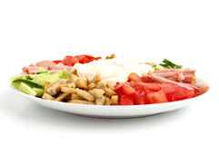 Salad in a bowl. On a white background Royalty Free Stock Image