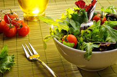 Salad in a bowl on bamboo tablecloth front view Stock Photo